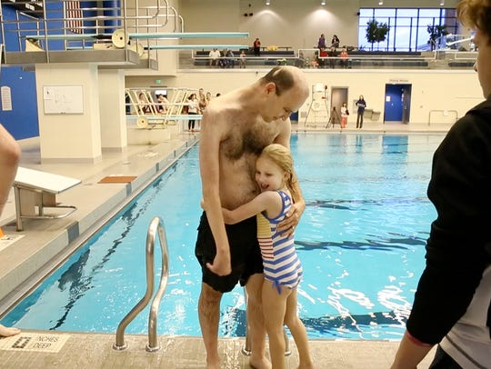 THE PHOTO:  Cliff Devries, diving coach at RIT, gets