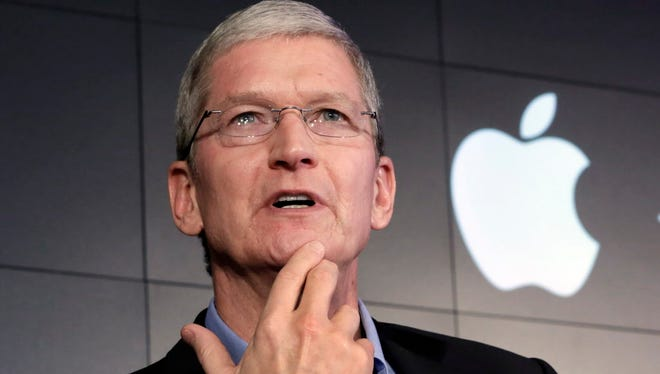 In this April 30, 2015 file photo, Apple CEO Tim Cook responds to a question during a news conference at IBM Watson headquarters, in New York.