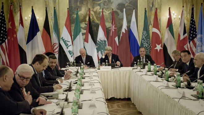 Representatives from the United Nations, United States and Russia meet with foreign ministers for talks on Syria at a hotel in Vienna, Austria on Oct. 30, 2015.