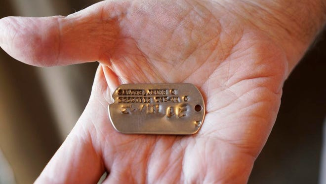 The missing dog tag belonging to James Q. Salter.