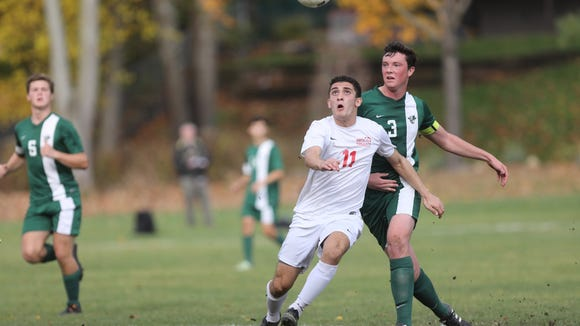 All-Passaic selection Carlo Gonzalez (11) of Pompton Lakes and Sophus Schanche of Kinnelon keep their eye on the ball during the second half. Pompton Lakes won the North 1 Group 1 game, 1-0. Thursday, November 3, 2016