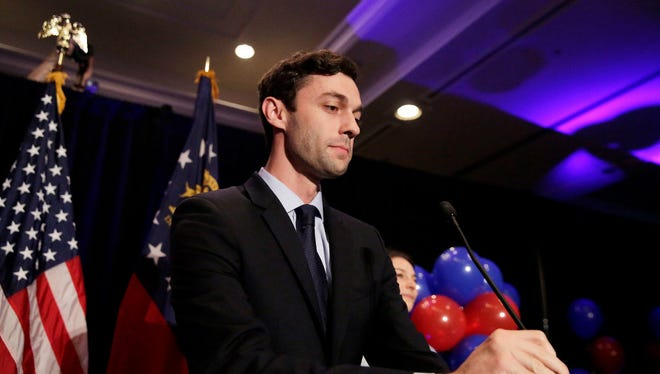 Democratic 6th district congressional candidate Jon Ossoff adjusts his microphone as he concedes to Republican Karen Handel at his election night party in Atlanta, Ga., Tuesday.