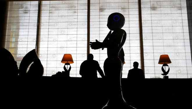 In this Nov. 15, 2017, photo, a robot named Pepper stands in the lobby of the Mandarin Oriental in Las Vegas. Pepper is programmed to interact with guests and answer pre-programmed questions.
