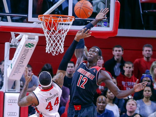 Louisville forward/center Mangok Mathiang blocks the shot of Rutgers forward J.J. Moore as he drives to the basket at the Louis Brown Athletic Center.