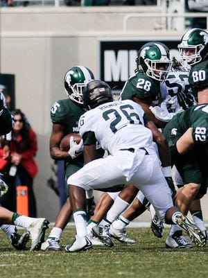MSU's Brandon Randle moves in to tackle MSU Darrell Stewart Jr. during the 2017 Green & White football game, Saturday, April 1, 2017, at Spartan Stadium in East Lansing.