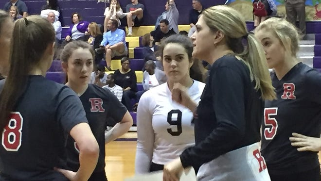Ruston volleyball coach Amanda Cauley makes a point to her team during a timeout against Byrd Tuesday night.