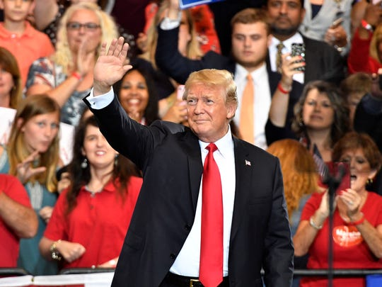 President Donald Trump waves to the crowd during a rally at Municipal Auditorium, Tuesday, May 29, 2018, in Nashville, Tenn.
