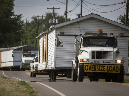 May 12, 2016: Two of the four homes where members of the Rhoden family were shot and killed on the morning of April 22, are transported from Union Hill Road properties to a warehouse in Waverly, which is being used as a command center for authorities. Dozens of vehicles from the Rhoden properties had also been taken to the center in recent days.