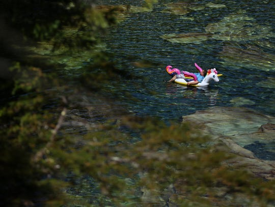 A man floats at Three Pools Recreation Area in the