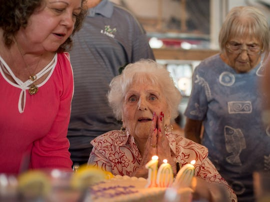 Elodie McCready, who turned 100 on Oct. 9, 2017, celebrates