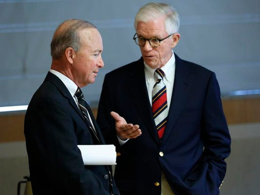 David J Williams and Mitch Daniels file shot