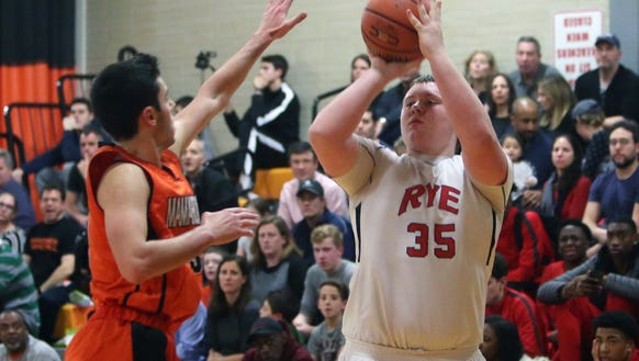 Rye's A.J. Thompson attempts a shot during his team's 53-34 win at Mamaroneck High School Jan. 12, 2018.