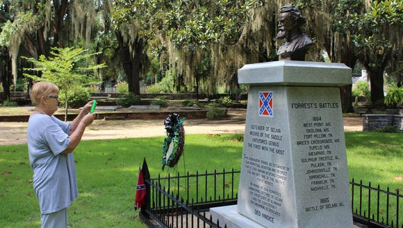 Tourist takes a photo of the Nathan Bedford Forrest