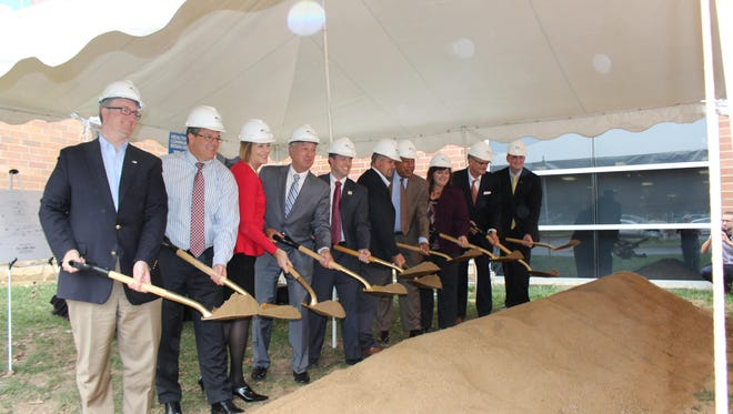 Representatives from the YMCA of Greater Cincinnati, St. Elizabeth Healthcare and others during the ceremonial groundbreaking marking the R.C. Durr YMCA expansion in Burlington on Nov. 3.