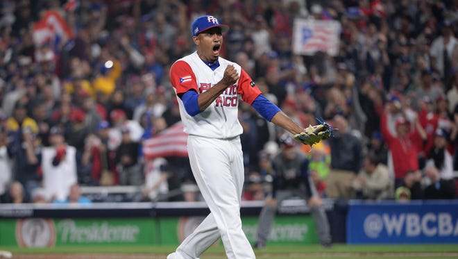 Puerto Rico closer Edwin Diaz reacts after recording the last out against the United States on Friday night in a World Baseball Classic game in San Diego. Puerto Rico won 6-5.