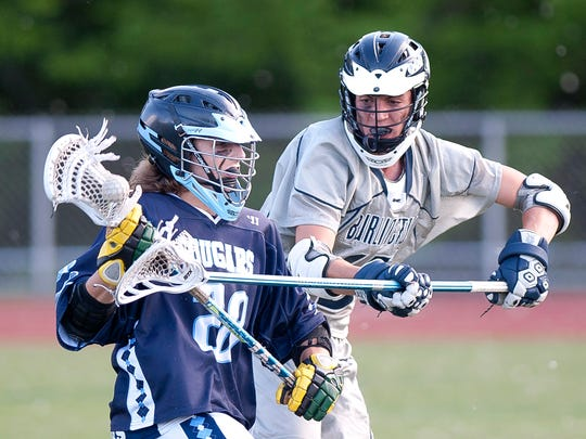 Mount Mansfield's Jaden Elsinger, left, in action during the 2017 high school boys lacrosse playoffs.