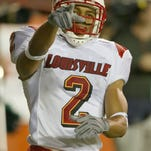 Louisville wide receiver Tiger Jones celebrates his touchdown during the first half against Miami, Thursday, Oct. 14, 2004, in Miami. (AP Photo/Wilfredo Lee)