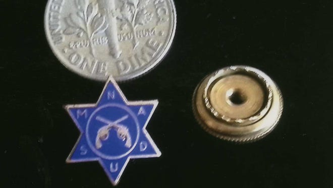Can you tell us about this lapel pin?