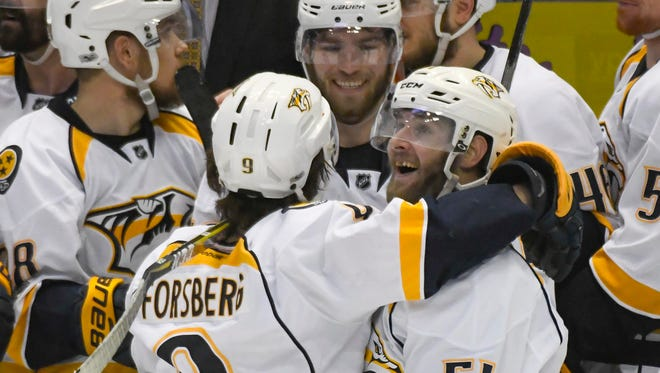 Predators left wing Austin Watson (51) celebrates his third-period goal with teammate Filip Forsberg (9) during Game 5 of the NHL Western Conference finals against the Anaheim Ducks at Honda Center in Anaheim, Calif.
