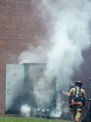 Greenville firefighters extinguish a fire in a transformer at the TD Convention Center on Thursday, May 26, 2016.