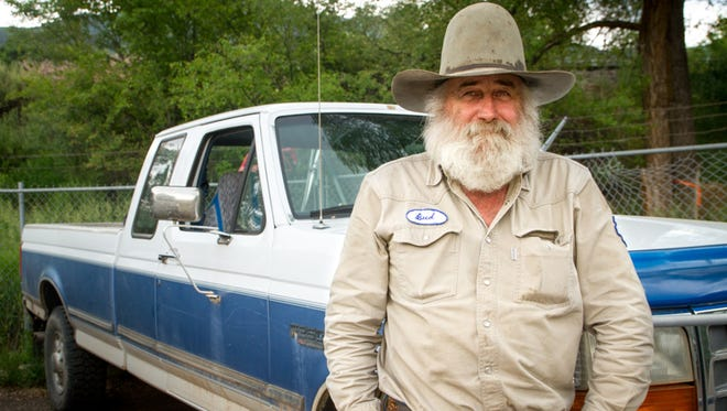 In this Wednesday, June 22, 2016, photograph, Bud Gardner is shown in Glenwood Springs. Gardner works as a pest animal trapper for Colorado Parks and Wildlife.