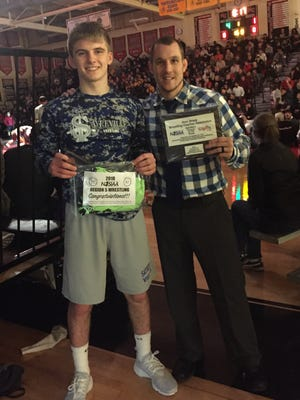 Marcus Ivy (right), pictured with state qualifier Trevor Mastorio, is the Home News Tribune's 2017-18 Wrestling Coach of the Year