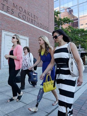 Boston Marathon bombing survivor Rebekah Gregory, second from right, walks towards the Moakley Federal Courthouse in Boston, Wednesday, June 24, 2015. More than 20 victims of the Boston Marathon bombing and their family members are expected to address the court regarding the attack's impact on their lives before a judge formally sentences bomber Dzhokhar Tsarnaev to death. (AP Photo/Charles Krupa)