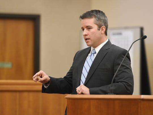 Deputy District Attorney Daniel McDonald delivers an