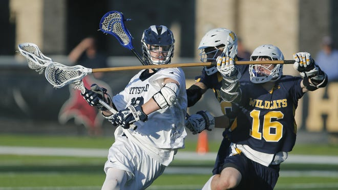 LAX Class A boys: Pittsford's Brandon Barker brings the team to just a goal behind with 7-8 in the fourth quarter as West Genesee's Grainger Sasso defends, but Pittsford would end up loosing the game with that score at St. John Fisher College.