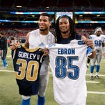 Rams running back Todd Gurley, right, and Lions tight end Eric Ebron trade jerseys following the Lions' loss Sunday in St. Louis.