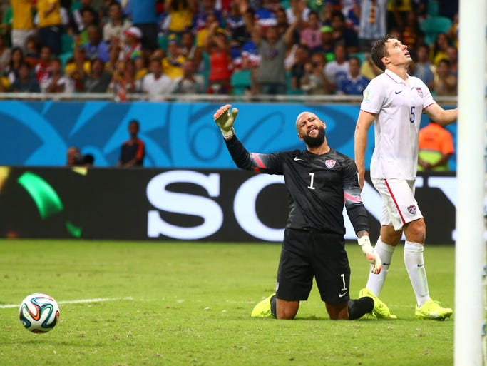 Jul 1, 2014; Salvador, BRAZIL; United States goalkeeper Tim Howard (1) and defender Matt Besler (5) react after a Belgium goal in overtime during the round of sixteen match in the 2014 World Cup at Arena Fonte Nova. Mandatory Credit: Mark J. Rebilas-USA TODAY Sports