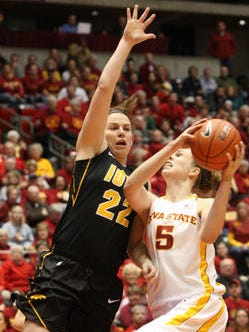 Iowa's Samantha Logic (left) and Iowa State's Hallie Christofferson both received honorable mention All-American recognition from the Associated Press.