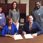 The DeSoto Parish School Board and the Northwest Louisiana Technical College have signed a Memorandum of Understanding to improve and expand occupational training for high school students. Mrs. Dianne Clark (Interim Director of NWLTC) and Dr. Cade Brumley (Superintendent of DeSoto Parish Schools) are shown signing the agreement. Pictured behind from left to right, and vital to the agreement, are Haley Holder (NWLTC Coordinator), Amy Johnson (NWLTC Coordinator), and Dr. Darrell Hampton (Director of Student Services for DeSoto Parish Schools).