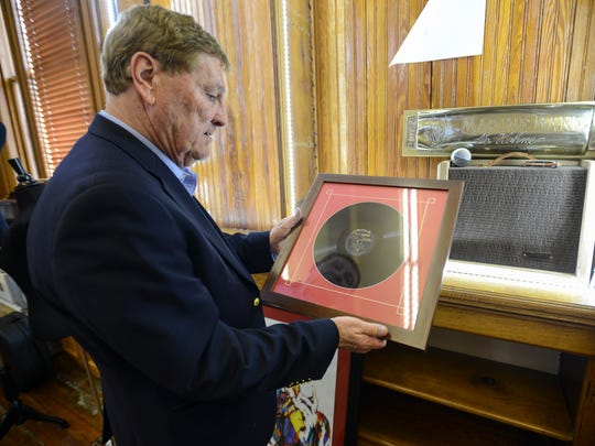 "Jimmy Exum holds a ""Sonny Boy"" Williamson album at the Carnegie museum in downtown Jackson."