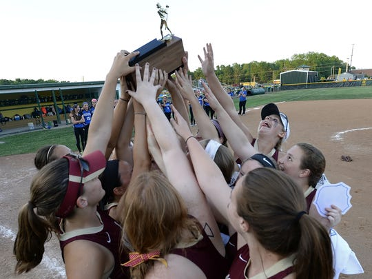 Pittsford Mendon players raise the championship trophy following the Section V Class A1 Championship played at SUNY Brockport on Thursday, May 28, 2015.