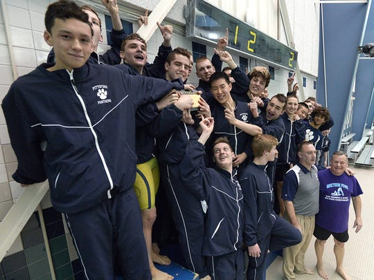 Pittsford swimmers stand on the podium after winning the Section V Class A Boys Swimming Championship Finals held at the Webster Aquatic Center on Friday, February 12, 2016.