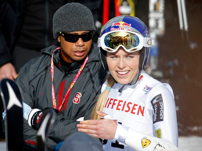Lindsey Vonn and Tiger Woods after her first run in