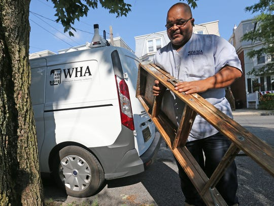 Bruce Jarvis carries a ladder into the Wilmington home of Bonnie Foote Wednesday. Jarvis completes repairs for properties owned by Wilmington Housing Authority. WHA's Section 8 tenants live in properties owned by private landlords, and the authority is considering training for them akin to other programs in the state.