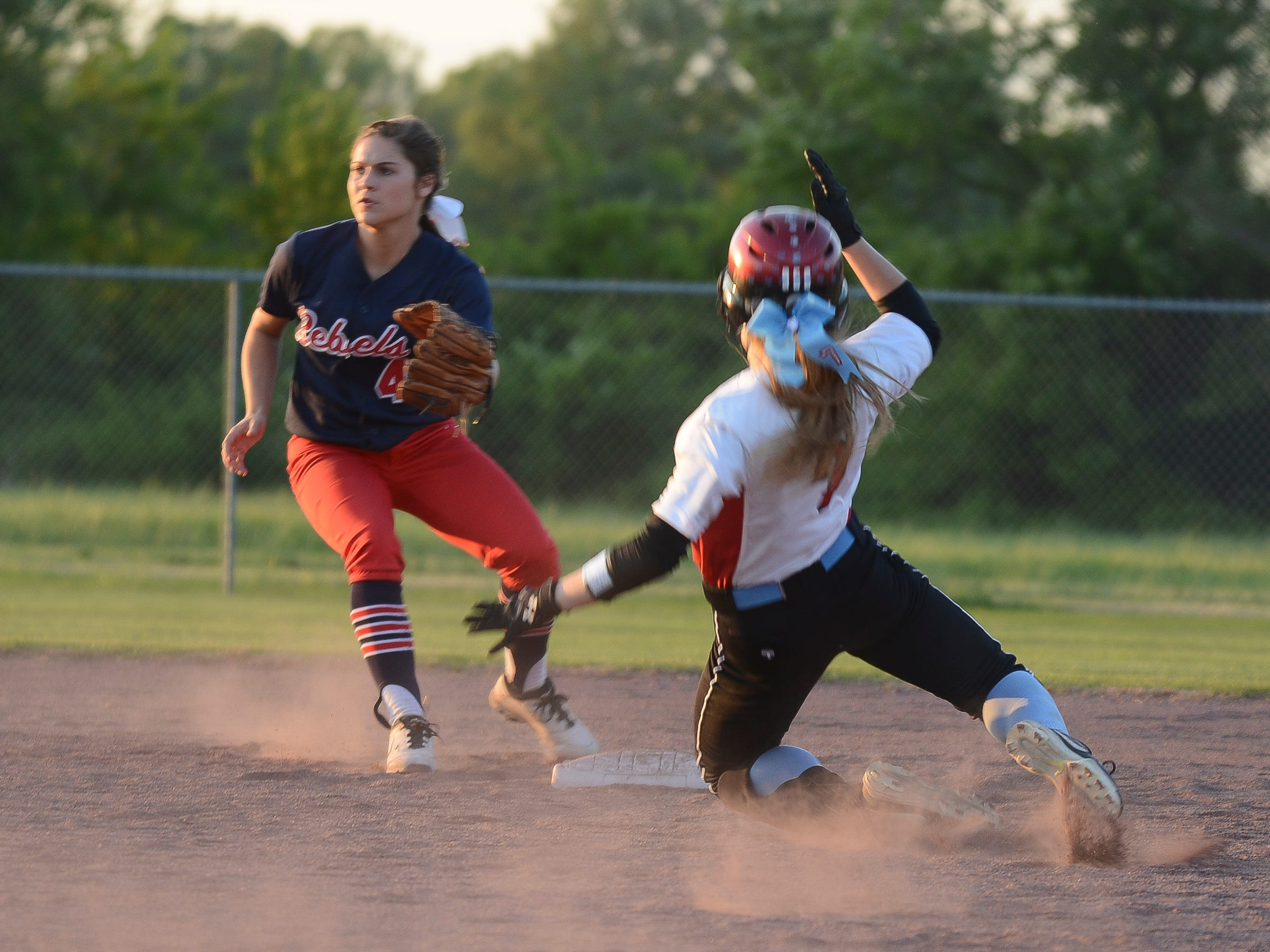 USJ's Addison Dunn slides into second base Tuesday evening during a game against Tipton-Rosemark.