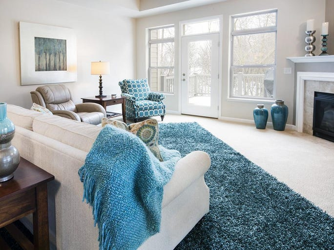 Layering a rug over carpet can be visually interesting if textures are done right.