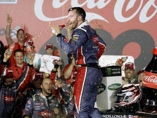 Austin Dillon celebrates in Victory Lane after winning the NASCAR Cup series auto race at Charlotte Motor Speedway in Concord, N.C., Monday, May 29, 2017. (AP Photo/Chuck Burton)