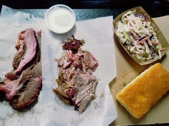 Chester White's brisket and pulled pork combo with corn bread and coleslaw. Platters are served with one side item: mac and cheese, coleslaw, baked beans or veggie of the day.