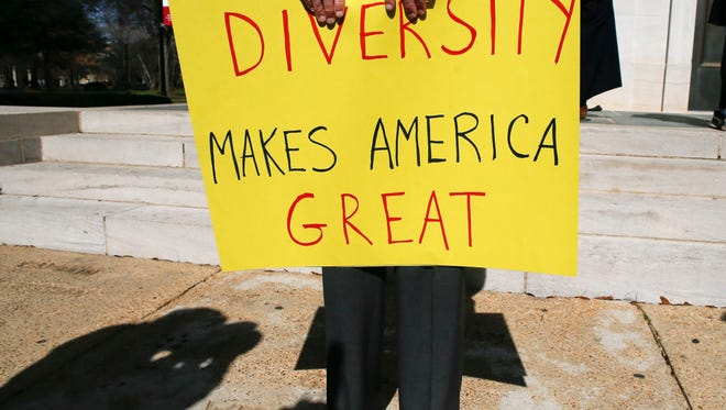 Professor Fran O'Neal holds a sign during a Feb. 9 gathering at the University of Alabama in Tuscaloosa, to support an open campus and oppose the travel ban imposed by President Donald Trump.