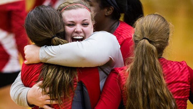 Powdersville's Maeve Matter hugs her teammate after Powdersville scored a point in the third set during the Palmetto vs. Powdersville volleyball game on Thursday, October 13, 2016 in Williamston.
