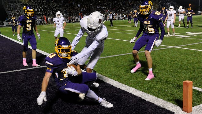Wylie High School's Brady Horn scores a touchdown in overtime against Brownwood. Wylie won its district opener, 45-38, in three overtimes.