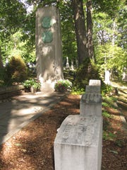 The cemetery plot for the Langdon and Clemens families in Elmira's Woodlawn Cemetery. Headstoes for Mark Twain and his family are shown bottom right, while the monument to Twain and his son-in-law is seen in the rear.