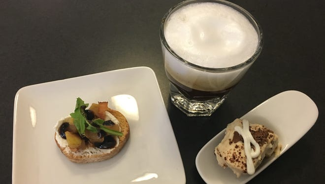A crouton topped with goat cheese, caramelized pears, arugula and a vinaigrette served with a coconut cream coffee and tiramisu. This was a course in the Chef Challenge for Children.