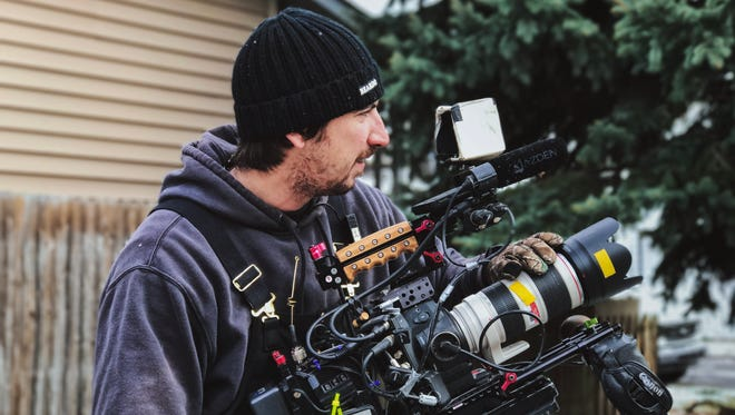 """Mike James wields his Canon C300 to capture a shot on the set of """"Good Bones."""""""