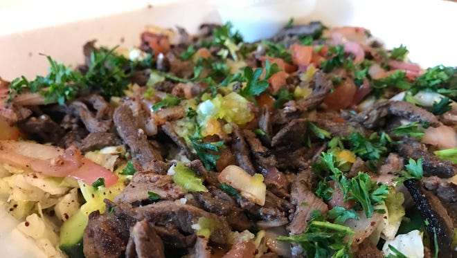 The shawarma salad, shown here with lamb, from Kabab Village in Fort Myers.