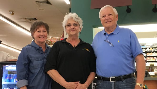 Karen Murfin, left, and Chuck Murfin, Sr., say goodbye to Kathy Warden after 35 years of employment at family-owned Murfin's Market in Ozark, Mo.